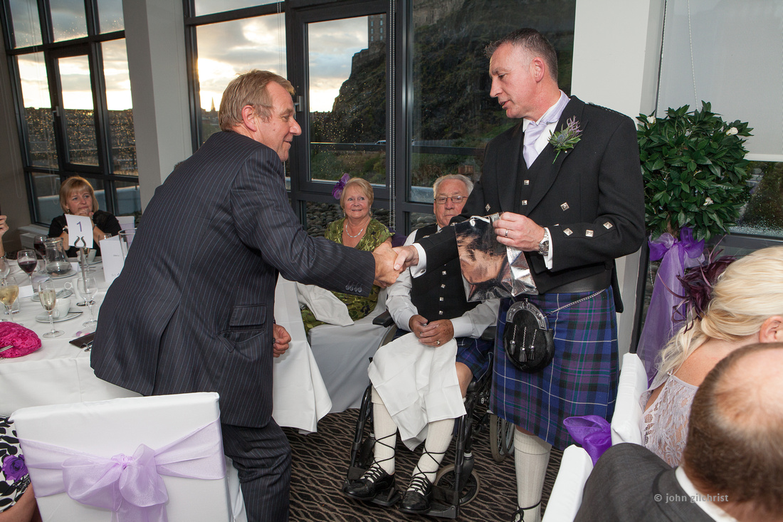 Sample wedding image from Edinburgh Castle and Apex Hotel Grassmarket, photographer John Gilchrist ref 20140906-0057