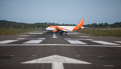 Passenger jet aircraft on runway lined up on take off run