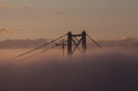 Haar rolling in and engulfing the Forth Road Bridge