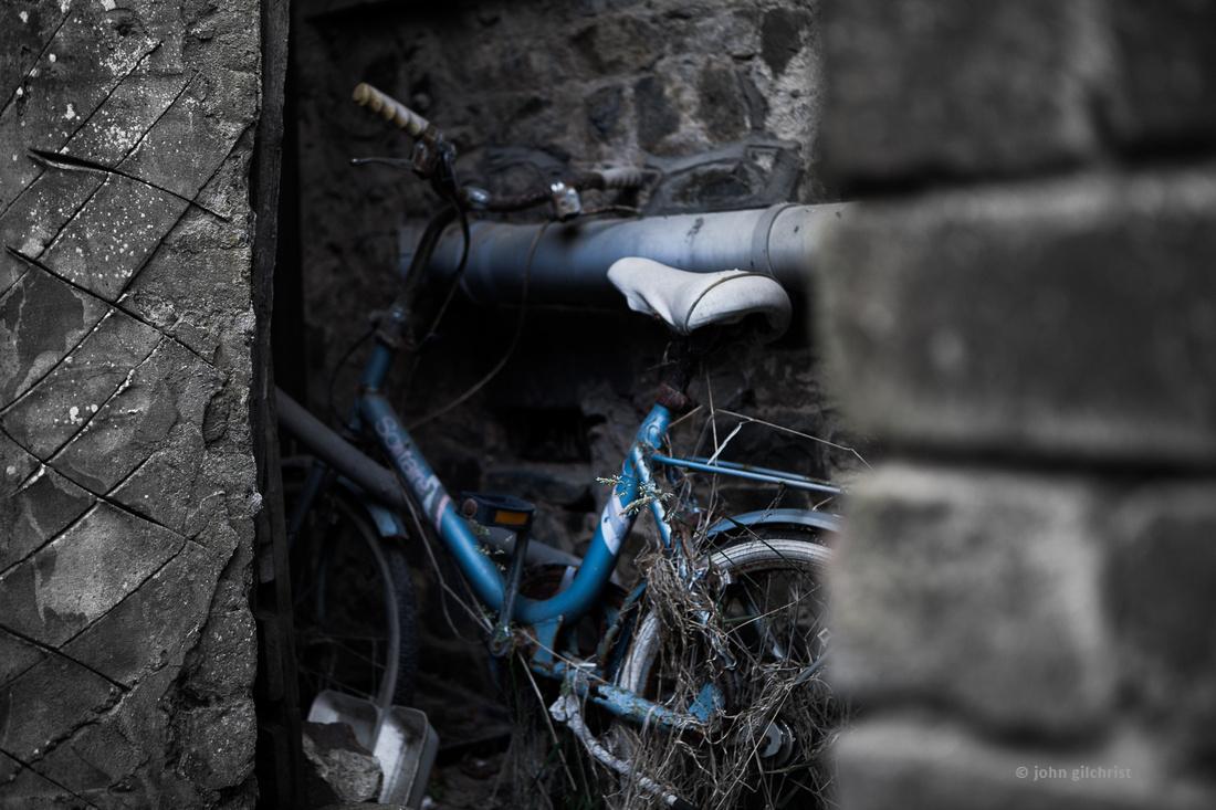 DISCARDED old bike hidden away.