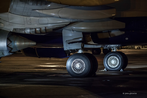 Edinburgh Airport, aircraft undercarriage, main landing gear leg and 2-wheel bogie pictured at night, 09 February 2014
